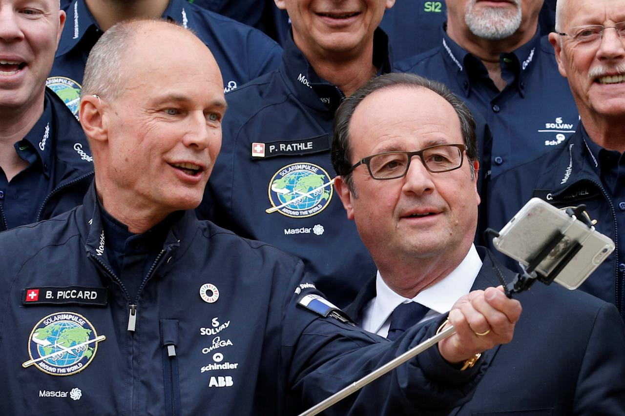 French President, Francois Hollande (R) poses for a selfie with Swiss aviator Bertrand Piccard (L) of Solar Impulse, at the Elysees Palace in Paris, France, April 25, 2017. REUTERS/Pascal Rossignol