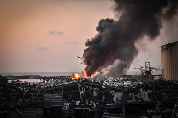 A military helicopter tries to put out a fire at the port after the explosion in Beirut, Lebanon.