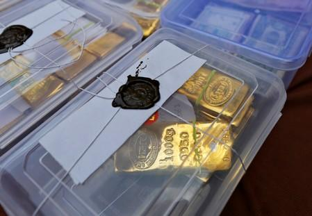 Seized gold bars are kept on display by Indian police officials at a police station in the western Indian city of Ahmedabad