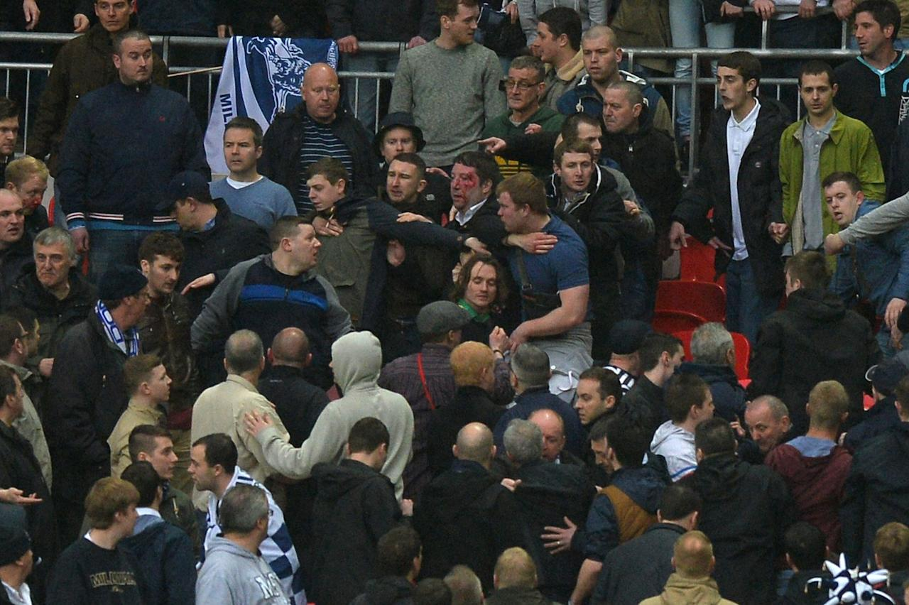 Millwall fans fight among themselves in the crowd during the FA Cup semi-final football match between Millwall and Wigan Athletic at Wembley Stadium in north London on April 13, 2013. Wigan won the game 2-0. AFP PHOTO/PAUL ELLIS  NOT FOR MARKETING OR ADVERTISING USE / RESTRICTED TO EDITORIAL USEPAUL ELLIS/AFP/Getty Images