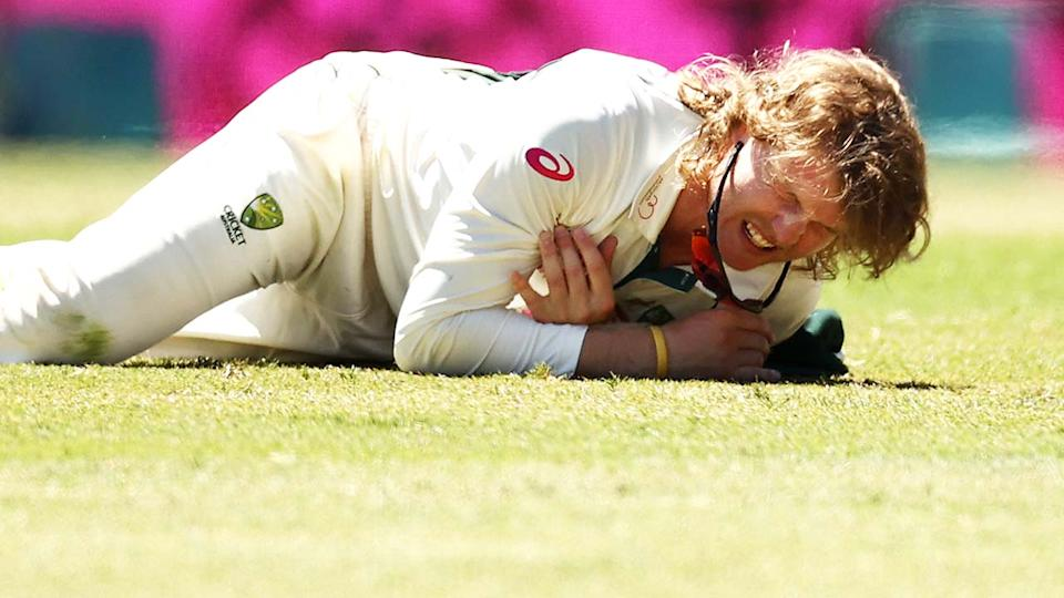 Will Pucovski, pictured here after diving to field a ball at the SCG.