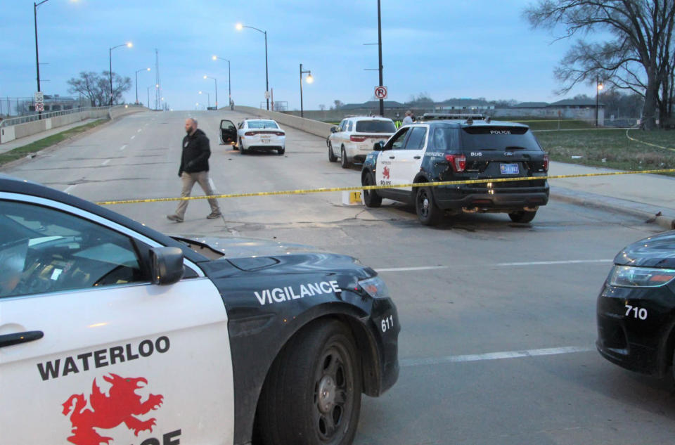Authorities are investigating an officer-involved shooting following a report of a man with a gun at the foot of the Sixth Street Bridge early Wednesday, April 7, 2021, in Waterloo, Iowa. In a lawsuit filed Thursday, Sept. 23, 2021, a man who was paralyzed when an Iowa police officer shot him in April is suing the officer. Marcelino Alvarez-Victoriano contends the shooting was not justified. Authorities say a Waterloo police officer shot Alvarez-Victoriano after he pointed a pellet gun that looked like a shotgun at two Black Hawk County sheriff's deputies. ( Jeff Reinitz/The Courier via AP)