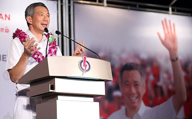 PM Lee's PAP party is returned to power by 60.1 per cent of votes -- the lowest winning margin since independence. (AP photo)