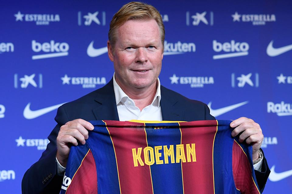 """Barcelona's new Dutch coach Ronald Koeman poses during his official presentation at the Camp Nou stadium in Barcelona on August 19, 2020. - Crisis-hit Barcelona hailed the """"return of a legend"""" as the Spanish giants today officially named Ronald Koeman as their new coach until 2022. (Photo by Josep LAGO / AFP) (Photo by JOSEP LAGO/AFP via Getty Images)"""