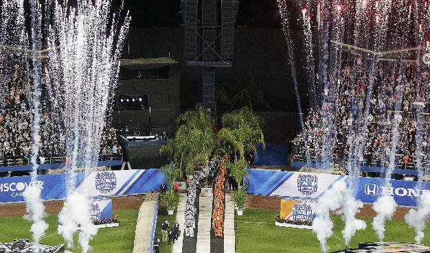 The Anaheim Ducks, center right, and the Los Angeles Kings are introduced before an NHL outdoor hockey game at Dodger Stadium on Saturday, Jan. 25, 2014, in Los Angeles. (AP Photo/Jae C. Hong)