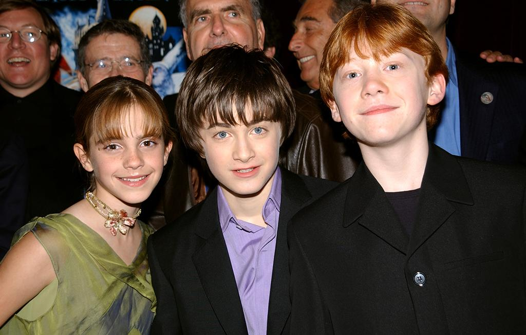 <p>The 11-year-old actress makes her big-screen debut in the first <em>Harry Potter</em> film alongside co-stars Daniel Radcliffe and Rupert Grint. The young trio poses at the New York premiere on Nov. 11, 2001. (Photo: Richard Corkery/Getty Images) </p>
