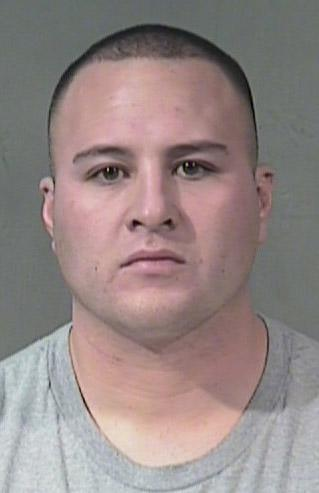 An undated photo provided by the Chandler, Ariz., Police Department of Adam Hernandez. Police identified Hernandez, 27, as the suspect in a shootout at an upscale shopping center in suburban Phoenix Wednesday, Jan. 5, 2011, where he allegedly exchanged gunfire with officers and then entered a nearby Baja Fresh fast food restaurant, fired several shots and held off police for nearly three hours before surrendering, Chandler police said. Hernandez surrendered Wednesday afternoon and no injuries were reported, officials said.  (AP Photo/Chandler, Ariz., Police Department)