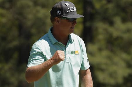 Charley Hoffman of the U.S. celebrates saving par on the first hole in third round play during the 2017 Masters golf tournament at Augusta National Golf Club in Augusta, Georgia, U.S., April 8, 2017. REUTERS/Brian Snyder