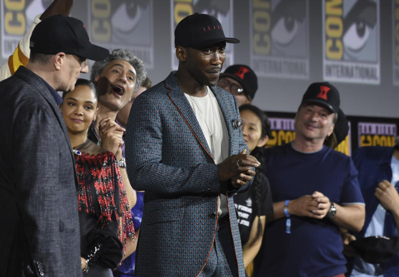 """Mahershala Ali, center, wears a hat to promote his new movie """"Blade"""" at the Marvel Studios panel on day three of Comic-Con International on Saturday, July 20, 2019, in San Diego. (Photo by Chris Pizzello/Invision/AP)"""
