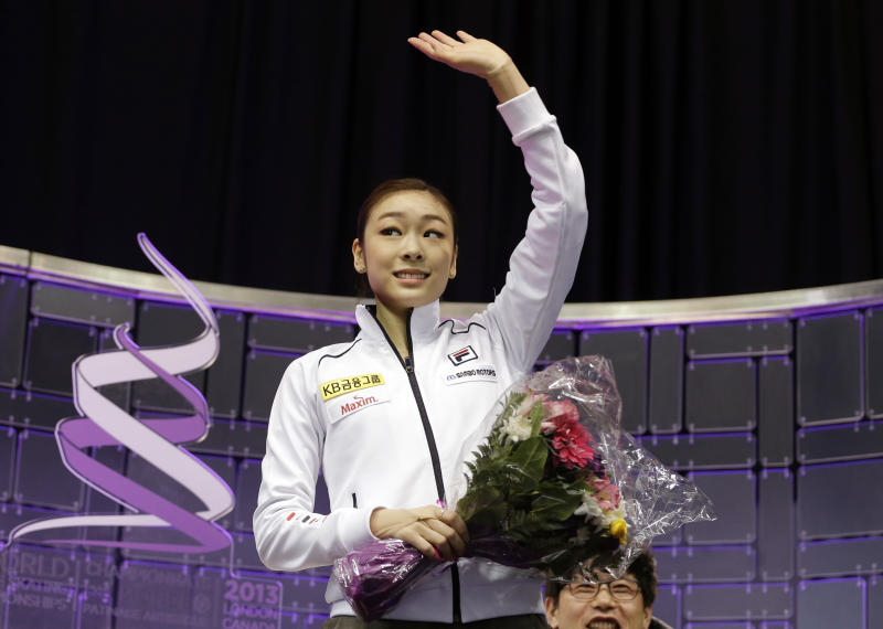 Kim Yu-na, of South Korea, reacts after watching her scores during the free skate program in the ladies competition at the World Figure Skating Championships Saturday, March 16, 2013, in London, Ontario. (AP Photo/Darron Cummings)