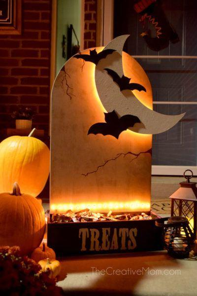 """<p>This light-up candy display is perfect for homeowners who plan to venture out on Halloween, but still want to give out goodies.</p><p><strong>Get the tutorial at <a href=""""http://www.thecreativemom.com/diy-halloween-candy-holder/"""" rel=""""nofollow noopener"""" target=""""_blank"""" data-ylk=""""slk:The Creative Mom"""" class=""""link rapid-noclick-resp"""">The Creative Mom</a>.</strong> </p>"""