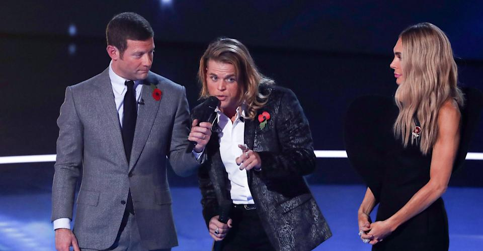 Dermot O'Leary, ousted contestant Gio Spano and new judge Ayda Field. (REX)