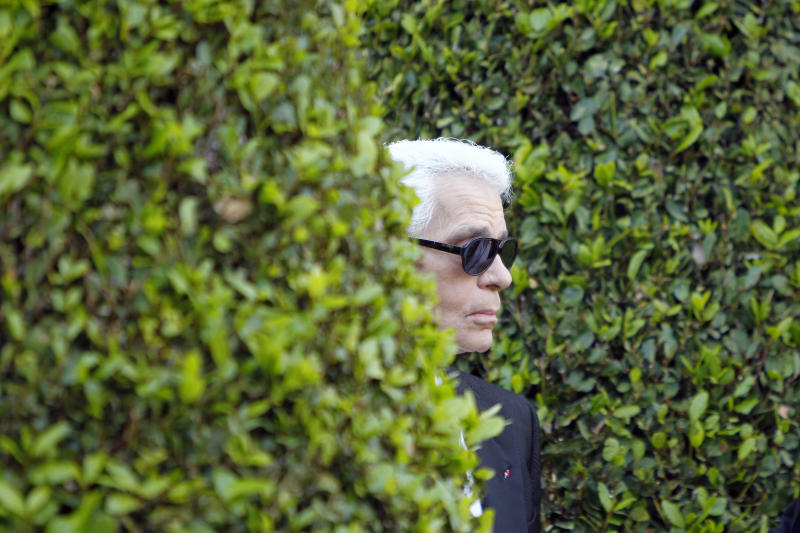 """Fashion designer Karl Lagerfeld appears at the end of the show for Chanel as part of """"Croisiere 2011-2012"""" presented at the Cap d'Antibes, near Cannes, ahead of the 64th Film Festival, Monday, May 9, 2011. The fashion show is followed by the screening of the film """"The Tale of a Fairy"""" directed by Karl Lagerfeld. (AP Photo/Francois Mori)"""