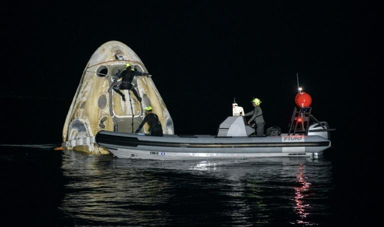 The SpaceX Crew Dragon capsule carrying four astronaunts was retrieved from the Gulf of Mexico and the crew will be flown to Houston after medical checks
