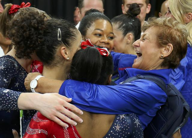 2016 Rio Olympics - Artistic Gymnastics - Preliminary - Women's Qualification - Subdivisions - Rio Olympic Arena - Rio de Janeiro, Brazil - 07/08/2016. Team Coordinator Marta Karolyi (R) hugs Gabrielle Douglas (USA) of USA (Gabby Douglas), Alexandra Raisman (USA) of USA (Aly Raisman), Laurie Hernandez (USA) of USA, Simone Biles (USA) of USA and Madison Kocian (USA) of USA during the women's qualifications. REUTERS/Mike Blake FOR EDITORIAL USE ONLY. NOT FOR SALE FOR MARKETING OR ADVERTISING CAMPAIGNS.