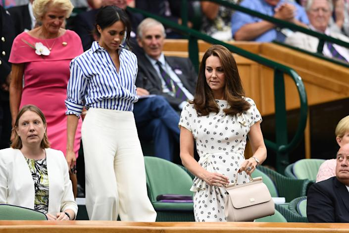 """<div class=""""caption""""> Catherine, Duchess of Cambridge (R) and Meghan, Duchess of Sussex attend day twelve of the Wimbledon Lawn Tennis Championships at All England Lawn Tennis and Croquet Club on July 14, 2018 in London, England. </div> <cite class=""""credit"""">Clive Mason</cite>"""