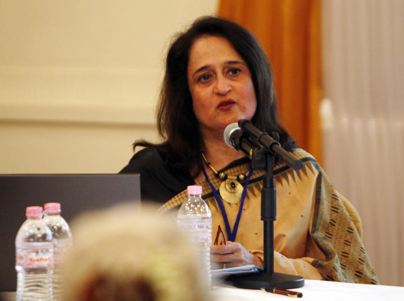 """Author Sudha Shah speaks with the title of """"The King (Thibaw) in Exile"""" during the first day session of the Irrawaddy Literary Festival at Inya Lake hotel Friday, Feb. 1, 2013, in Yangon, Myanmar. The country's first international literary festival opens Friday, featuring dozens of authors from around the world, including Nobel Peace Prize laureate Aung San Suu Kyi. (AP Photo/Khin Maung Win)"""