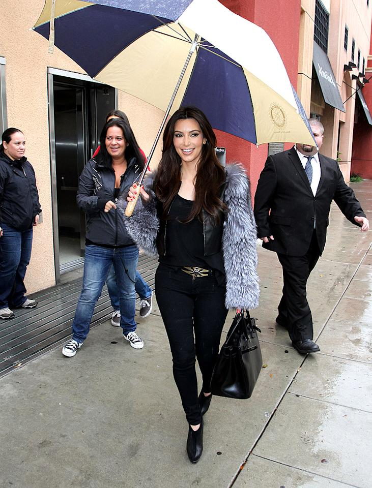 "Kim, 31, raved about the outing on Twitter. ""I'm in an extra good mood right now! Meeting up with @KourtneyKardash. Were doing something so exciting! #DashLA,"" she wrote. (2/15/2012)"