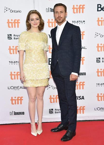 "Emma Stone, left, and Ryan Gosling arrive at the ""La La Land"" premiere on day 5 of the Toronto International Film Festival at the Princess of Wales Theatre on Monday, Sept. 12, 2016, in Toronto. (Photo by Evan Agostini/Invision/AP)"