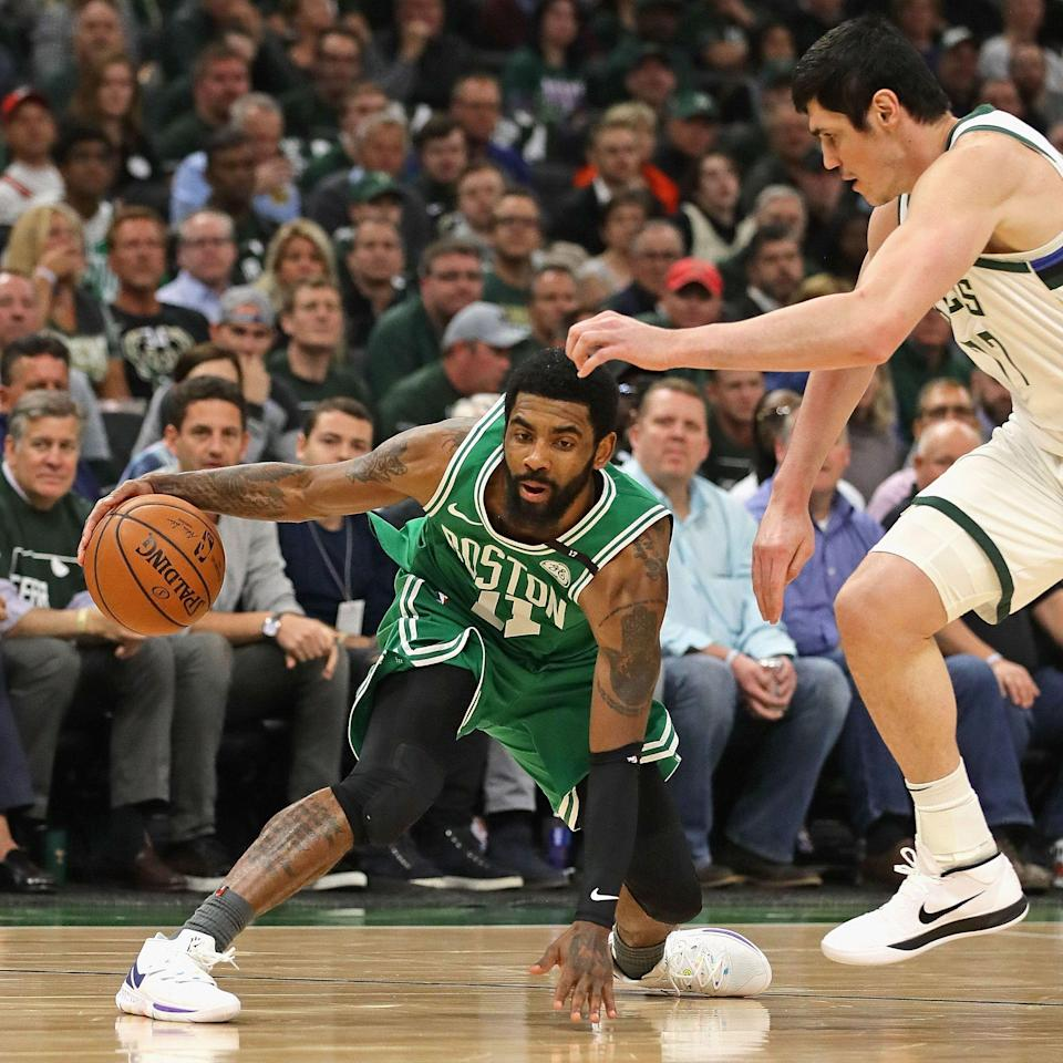 Kyrie Irving #11 of the Boston Celtics tries to move against Ersan Ilyasova #77 of the Milwaukee Bucks at Fiserv Forum on May 08, 2019 in Milwaukee, Wisconsin. NOTE TO USER: User expressly acknowledges and agrees that, by downloading and or using this photograph, User is consenting to the terms and conditions of the Getty Images License Agreement. (Photo by Jonathan Daniel/Getty Images)