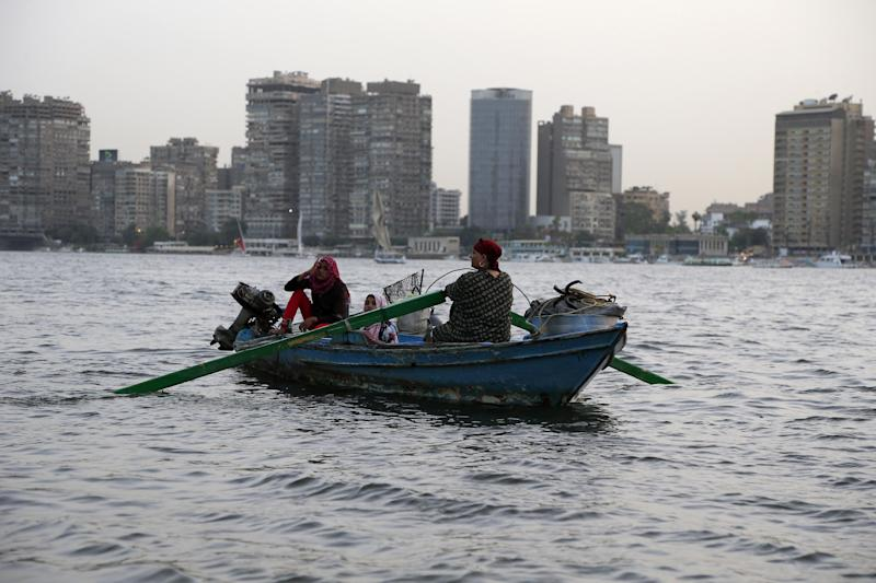 An Egyptian woman rows a boat with her family along the Nile River, in Cairo, Egypt, Friday, May 31, 2013. Ethiopia started to divert the flow of the Blue Nile river to construct a giant dam on Tuesday, according to its state media, in a move that could impact the Nile-dependent Egypt. Downstream nations Egypt and Sudan have objected to the construction, saying it violates a colonial-era agreement which reportedly gives Egypt nearly 70 percent of Nile River waters. (AP Photo/Hassan Ammar)