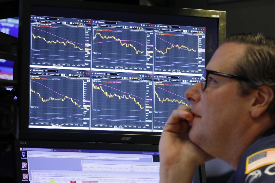 Specialist Gregg Maloney works at his post on the floor of the New York Stock Exchange, Wednesday, Oct. 10, 2018. (AP Photo/Richard Drew)