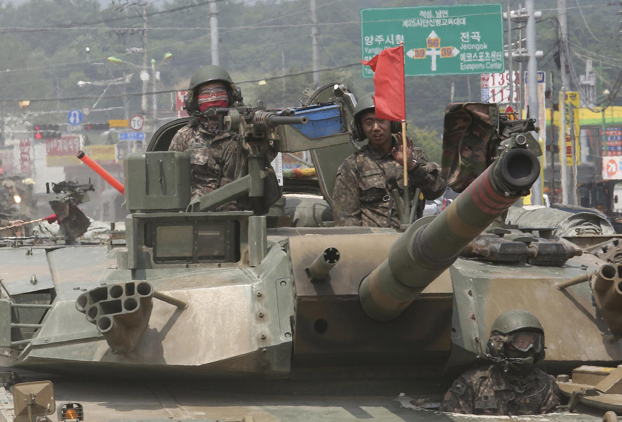 <p>South Korean army soldiers ride a K-1 tank during the annual exercise in Paju, South Korea near the border with North Korea, Wednesday, July 5, 2017. (Photo: Ahn Young-joon/AP) </p>