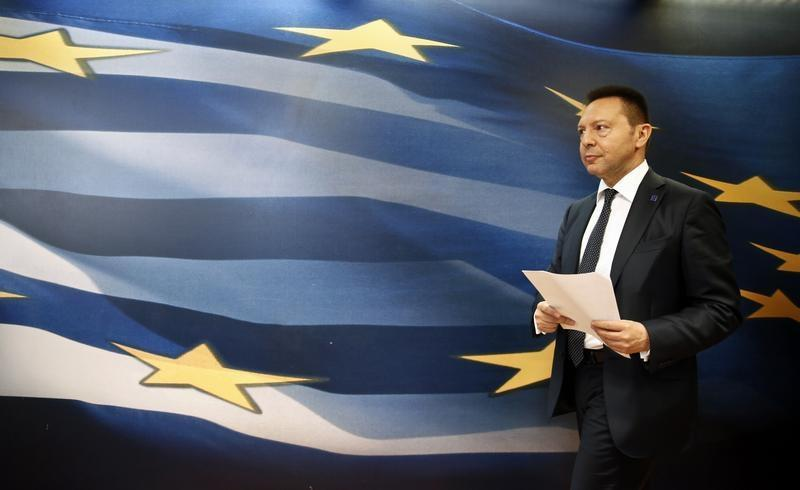 Greece's Finance Minister Stournaras arrives for a news briefing in Athens