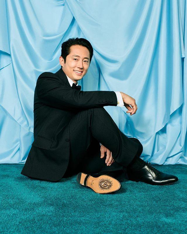 """<p>The <a href=""""https://people.com/movies/oscars-2021-first-time-nominees-andra-day-and-steven-yeun-discuss-their-roles-ahead-of-awards-show/"""" rel=""""nofollow noopener"""" target=""""_blank"""" data-ylk=""""slk:first-time Oscar nominee"""" class=""""link rapid-noclick-resp"""">first-time Oscar nominee</a> looked sharp in a black suit as he was in the running for Best Actor for his<a href=""""https://people.com/movies/steven-yeun-career-in-photos/"""" rel=""""nofollow noopener"""" target=""""_blank"""" data-ylk=""""slk:role as Jacob"""" class=""""link rapid-noclick-resp""""> role as Jacob</a> in <em>Minari</em>.</p>"""
