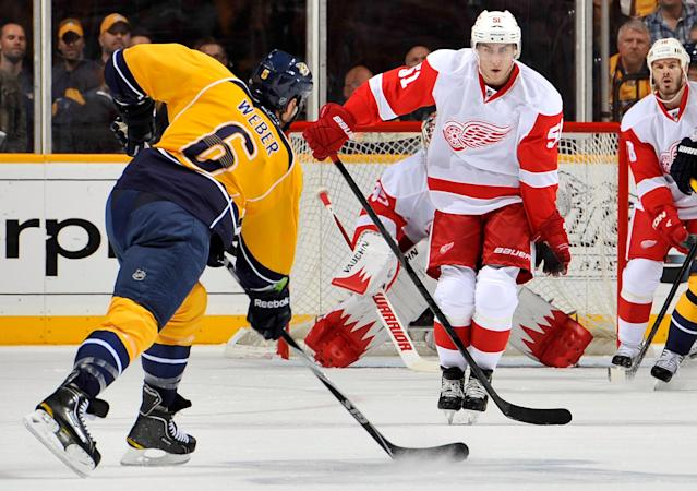 NASHVILLE, TN - APRIL 20: Shea Weber #6 of the Nashville Predators fires a slapshot toward Valtteri Filppula #51 of the Detroit Red Wings in Game Five of the Western Conference Quarterfinals during the 2012 NHL Stanley Cup Playoffs at the Bridgestone Arena on April 20, 2012 in Nashville, Tennessee. (Photo by Frederick Breedon/Getty Images)