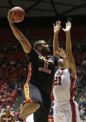 Oregon State's Joe Burton (11) shoots as Utah's Jordan Loveridge (21) defends in the first half during an NCAA college basketball game on Thursday, March 7, 2013, in Salt Lake City. (AP Photo/Rick Bowmer)