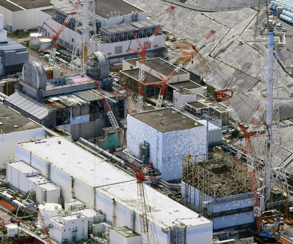 FILE - This Sept. 4, 2017, aerial file photo shows Fukushima Dai-ichi nuclear power plant reactors, from bottom at right, Unit 1, Unit 2 and Unit 3, in Okuma town, Fukushima prefecture, northeastern Japan. Its operator Tokyo Electric Power Company (TEPCO) says both of two seismometers at Unit 3, one of three melted reactors, had been out of order since last week and were not able to collect data when a powerful earthquake struck the area on Feb. 13, 2021, calling into question if the company's risk management has improved since the disaster. (Daisuke Suzuki/Kyodo News via AP, File)