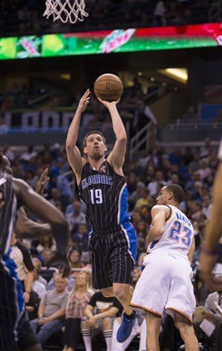 Orlando Magic's Beno Udrih (19) shoots for two points over Oklahoma Thunder's Kevin Martin (23) during the first half of an NBA basketball game on Friday, March 22, 2013, in Orlando, Fla. (AP Photo/Willie J. Allen Jr.)