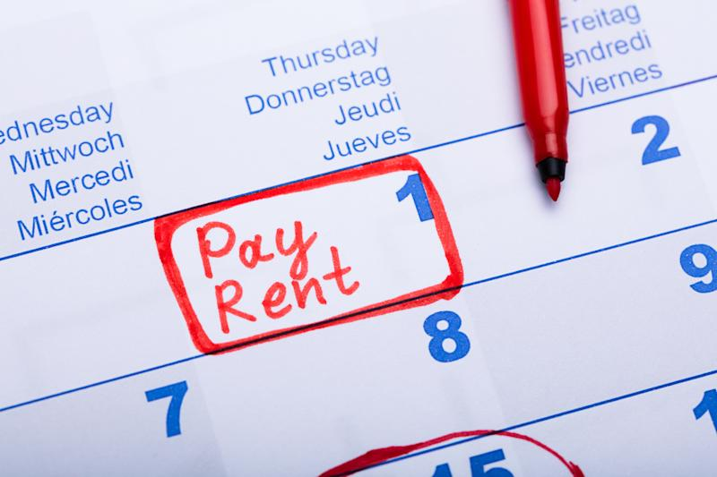 Pay Rent Note Made Using Red Marker In Paper Calendar