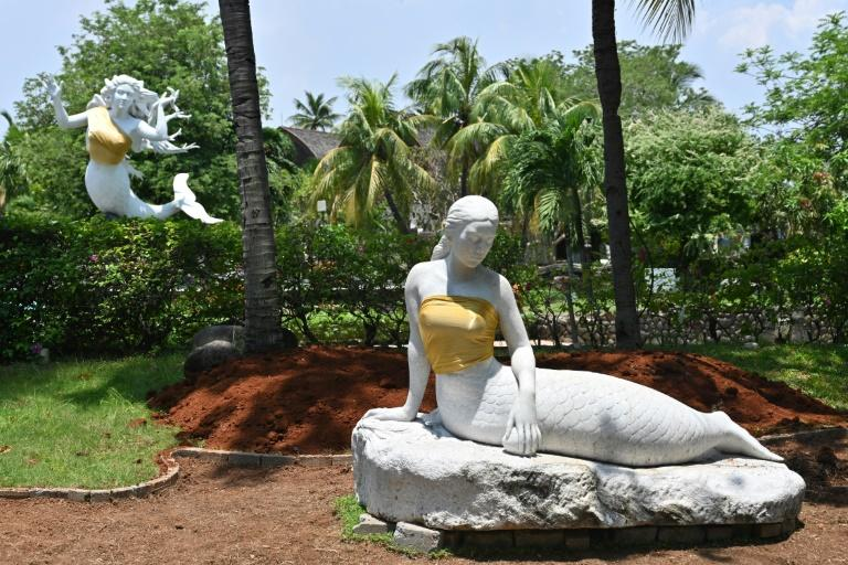 The bare chests of two mermaid statues have been covered up at an Indonesian theme park