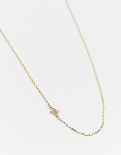 """<br><br><strong>DesignB London</strong> Initial Necklace in Gold 'M', $, available at <a href=""""https://www.asos.com/designb-london/designb-london-exclusive-initial-necklace-in-gold-m/prd/21643811?"""" rel=""""nofollow noopener"""" target=""""_blank"""" data-ylk=""""slk:ASOS"""" class=""""link rapid-noclick-resp"""">ASOS</a>"""