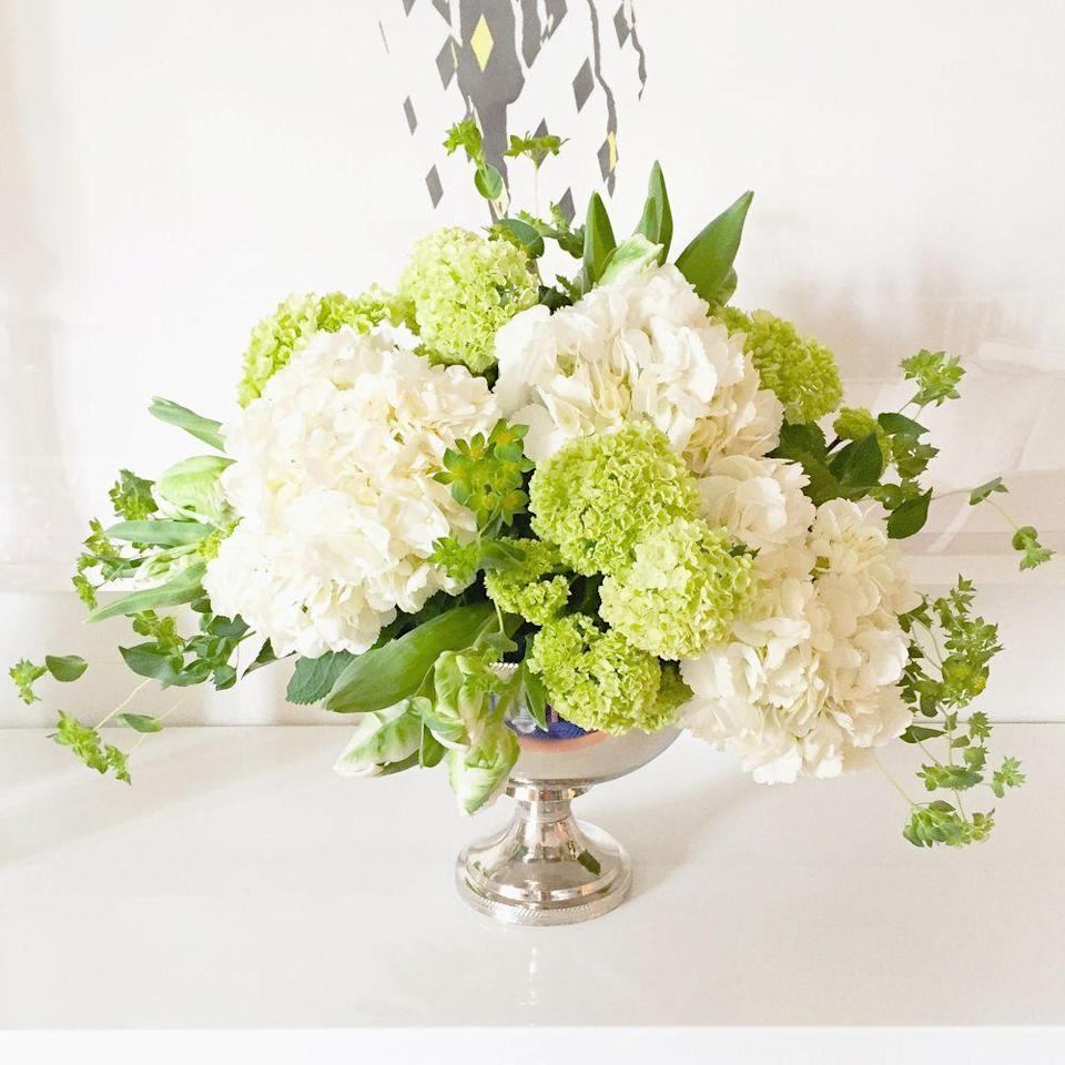 "<p>This gorgeous centerpiece will steal the show at your Christmas dinner—regardless of how much mouthwatering pie is on the table. A delicately-designed bouquet of white hydrangea, green viburnum, and white-and-green parrot tulips makes for a fresh approach to classic holiday decor.</p><p><em>Via </em><a href=""http://www.darlingtonavenue.com"" rel=""nofollow noopener"" target=""_blank"" data-ylk=""slk:Darlington Avenue"" class=""link rapid-noclick-resp""><em>Darlington Avenue</em></a></p>"