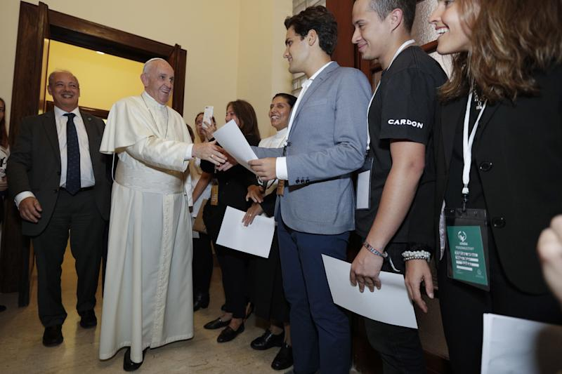 Pope Francis (C) greets people as he attends a meeting with members of the Scholas Occurrentes initiative, in Palazzo San Calisto in Rome on October 26, 2017.  (ANDREW MEDICHINI via Getty Images)