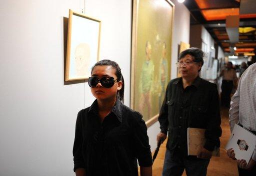 Visitors are seen browsing art work at a preview show of an auction house in Beijing, in May. Until recently, few in the art world had even heard of China's auction houses. Today, they are among the world's biggest by revenue, posing a serious challenge to the likes of Sotheby's and Christie's
