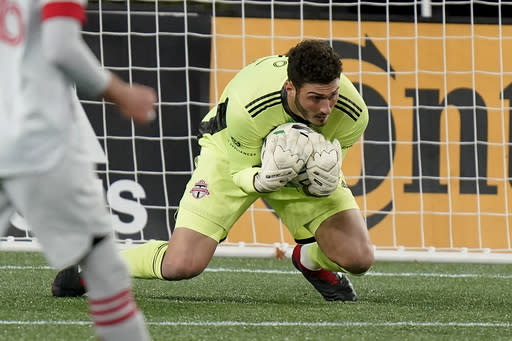 Toronto FC goalkeeper Alex Bono makes a save during the second half of the team's MLS soccer match against the New England Revolution, Wednesday, Oct. 7, 2020, in Foxborough, Mass. (AP Photo/Steven Senne)