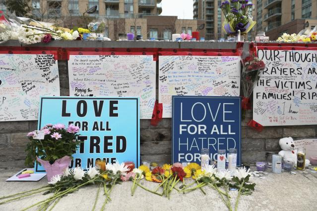 <p>Flowers and signs fill a memorial along Yonge Street Tuesday, April 24, 2018, in Toronto, the day after a driver drove a van down sidewalks, striking and killing numerous pedestrians in his path. (Photo: Galit Rodan/The Canadian Press via AP) </p>