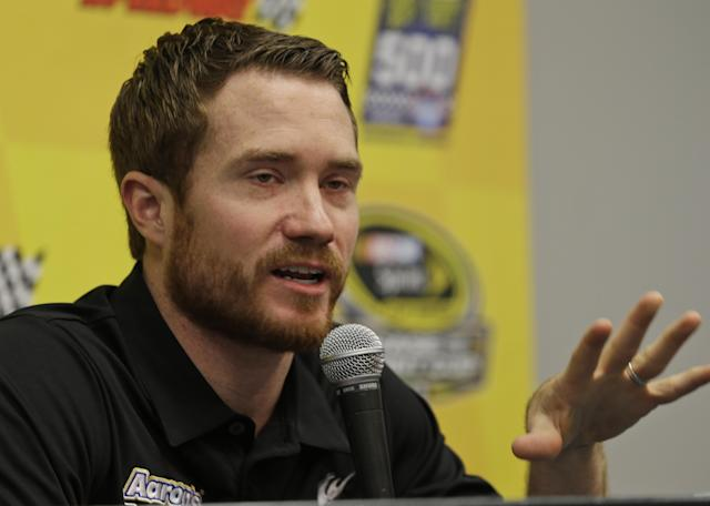 Sprint Cup driver Brian Vickers speaks to the media during a press conference at Martinsville Speedway in Martinsville, Va., Sunday, Oct. 27, 2013. Vickers was diagnosed with a blood clot in his right calf on Oct. 14 that has sidelined him the final five races of the season because of the blood thinners he's been prescribed. (AP Photo/Steve Helber)