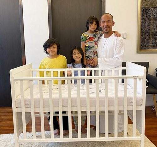 The father of four awaits for his youngest child to come home