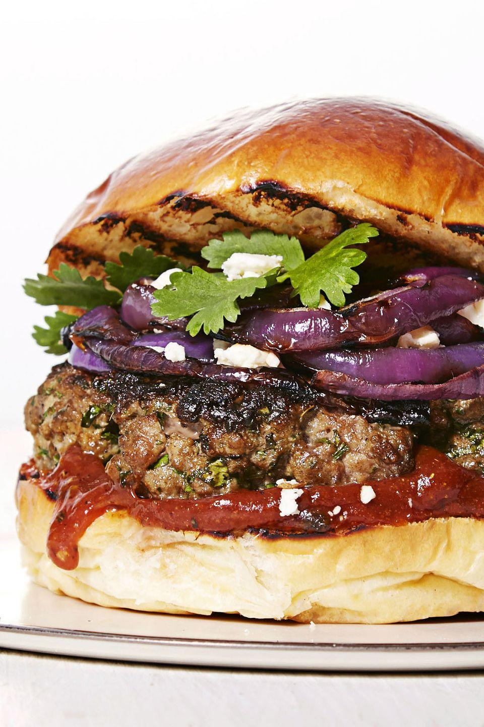 """<p>This patty is packed with cilantro, coriander, and garlic — and stacked with onions, curried ketchup, and feta cheese. Need we say more?</p><p><a href=""""https://www.goodhousekeeping.com/food-recipes/easy/a33404/mediterranean-spiced-burgers/"""" rel=""""nofollow noopener"""" target=""""_blank"""" data-ylk=""""slk:Get the recipe for Mediterranean Spiced Burger »"""" class=""""link rapid-noclick-resp""""><em>Get the recipe for Mediterranean Spiced Burger »</em></a></p>"""