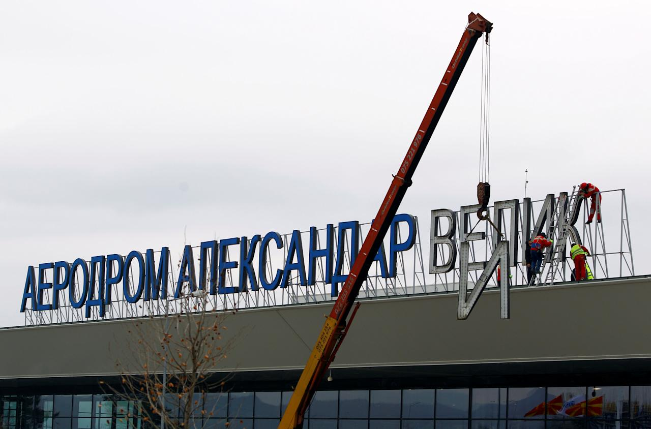 A worker dismantles the 'Alexander the Great' sign from the airport in Skopje, Macedonia February 24, 2018. REUTERS/Ognen Teofilovski