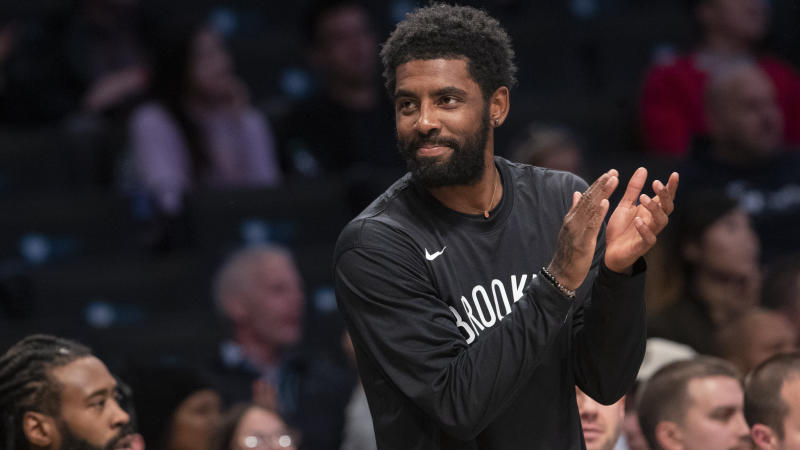 Brooklyn Nets guard Kyrie Irving reacts from the bench during the first half of an exhibition NBA basketball game against the Sesi/Franca Basketball Club, Friday, Oct. 4, 2019, in New York. (AP Photo/Mary Altaffer)