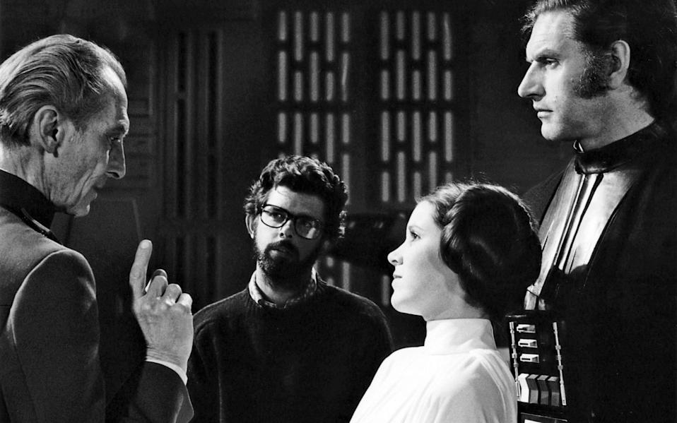 Dave Prowse on the set of Star Wars: Episode IV - A New Hope with Peter Cushing, George Lucas and Carrie Fisher - Corbis Historical