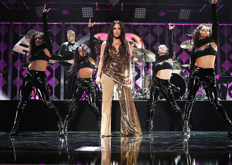 The 'Confident' singer took the stage to sing 'Confident,' 'Sorry Not Sorry' and more.