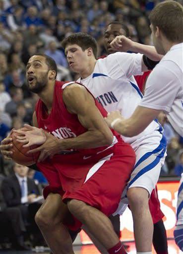Illinois State's Jackie Carmichael, left, works in front of Creighton's Doug McDermott, with Creighton's Grant Gibbs, right, helping on defense in the first half of an NCAA college basketball game in Omaha, Neb., Wednesday, Feb. 1, 2012. (AP Photo/Nati Harnik)