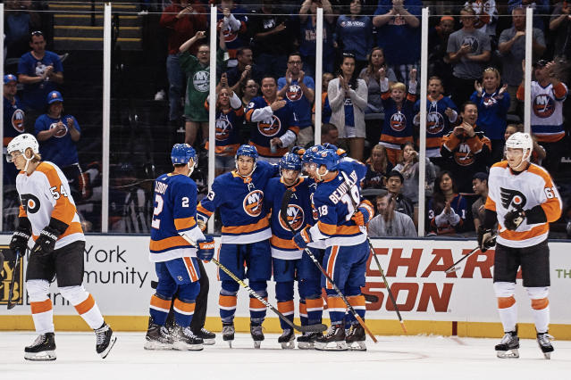 New York Islanders Kieffer Bellows, third right, celebrates with team mates after scoring, during the first period of a preseason NHL hockey game against Philadelphia Flyers in New York, Sunday, Sept. 16, 2018. (AP Photo/Andres Kudacki)